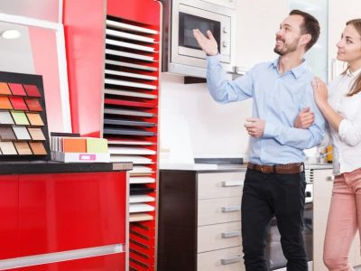 Couple choosing kitchen furniture materials